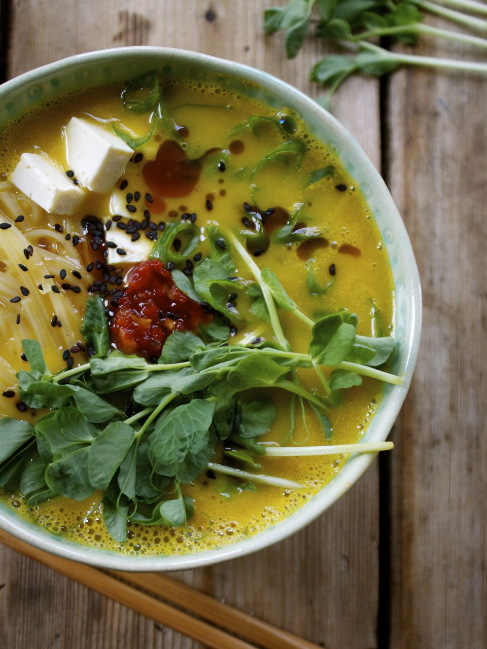 10 Minute Meal: Ramen Bowl w/ Squash Broth, Rice Noodles, Tofu & Fresh Pea Shoots10 Minute Meal: Ramen Bowl w/ Squash Broth, Rice Noodles, Tofu & Fresh Pea Shoots  The greatest wealth is to live content with little.  ― Plato  When it comes to ramen, I don't think there is a person in modern history without a connection or memory to warm noodles in a bowl and the comfort & subsequent memories they bring. I mean is there? For me and my siblings growing up, Mr. Noodles were a major treat, since while inexpensive and easy to make, my folks weren't exactly the 'fast food' types. But as most parents know, it is prudent to treat kids from time to time and so they did, even if it meant buying packages of cheap-as-borscht dry noodles that were laden with the salt & fake flavours from that little silver pouch, not to mention the MSG and whatever else goes into those iconic little packages of cheap & oh-so-tasty sustenance. Oh, Mr Noodles indeed.   Fast forward to now, when I'm lucky enough to be able to frequent (as many other Vancouverites are) a cozy little corner in Chinatown where the noodle bowl reigns supreme (and supremely done too I might add) without a salt pack or crinkly yellow package in site. For those who haven't been, Harvest Union is doing it all right, with hand-crafted bowls stuffed with all kinds of tasty, healthy surprises appealing to all eaters from vegan to those looking for meat options too. There is something for everyone at Harvest and it's here that I've recently re-discovered the bowl of hot soothing broth that contains not only perfectly cooked noodles, but all the other possibilities that work together to make a meal worth waiting for.  It was after a working lunch there recently that I was inspired to finally create a noodle bowl of my own, having been teased by various recipes here and there in the blogosphere. I set out to test my ideas with a few requirements, starting with wanting a gluten-free option. I'd worked enough with rice noodles to 