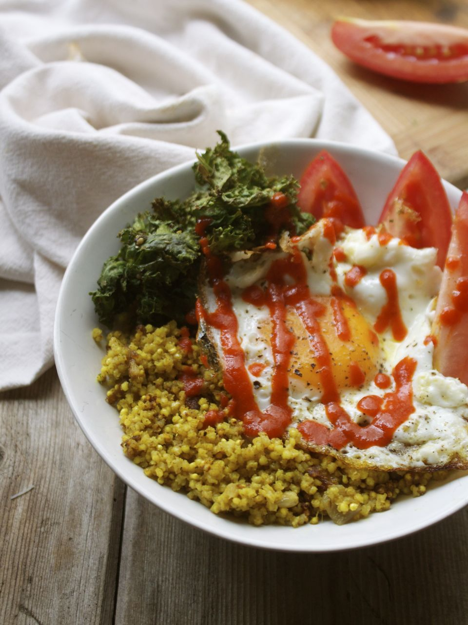 Coconut Curried Millet Pilaf with Crispy Kale, Tomato & Egg